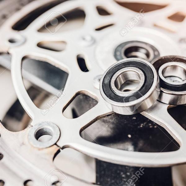 76824902-metal-ball-bearing-on-motorcycle-disk-brake-motorbike-repair.jpg