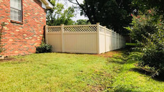 Tan Vinyl Privacy Fence with Lattice in Ripley Tennessee