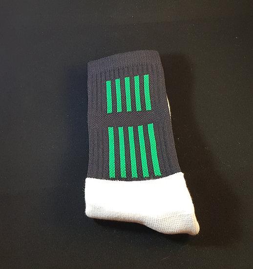 Black sock with green stripe