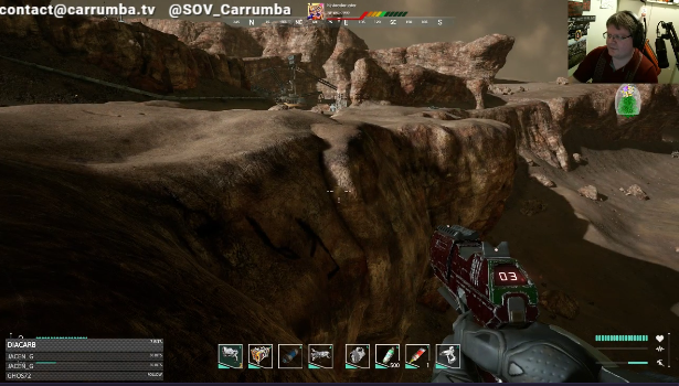 Memories of Mars screenshot with customised red and green pistol drawn at the edge of a cliff
