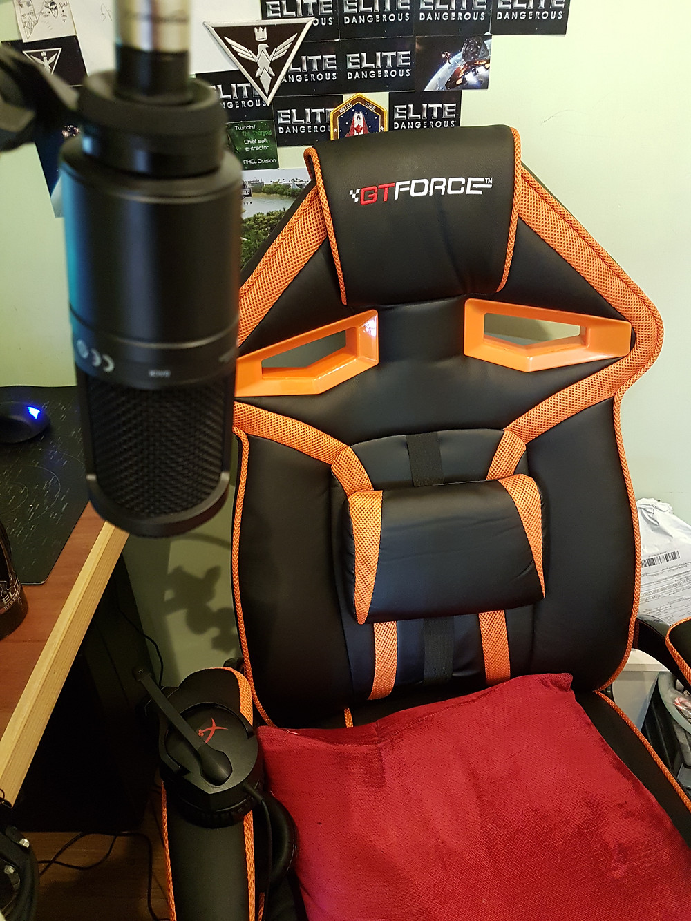 Picture of GTForce gaming chair. Black with orange trim in racing car style