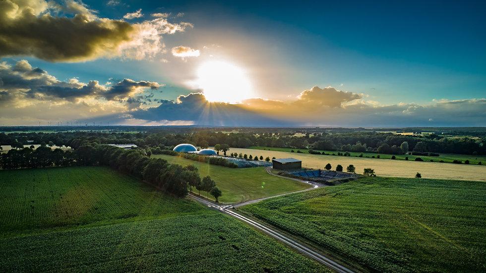 Biogas plant and corn field landscape.jp