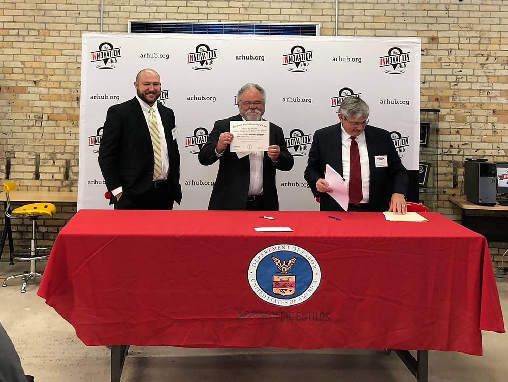 (L-R) Josh Rogers and Rodney Larsen of the Central Arkansas Planning and Development District, and USDOL OA State Director Lee Price (right) sign paperwork on Nov. 15 making the Central Area the first LWDA registered apprenticeship sponsor in Arkansas.