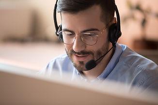 Focused businessman telemarketer telesales agent wear wireless headset make conference vid