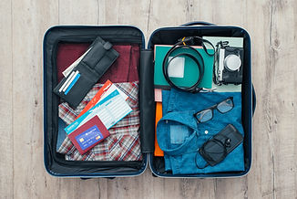 Open traveler's bag with clothing, acces