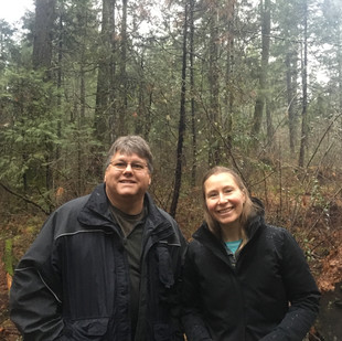 Jim and Calli-Jane in an overgrown forest