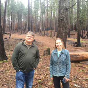 Jim and Calli-jane in an open forest