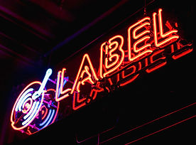 Label-Neon-Sign-By-Nick-Hillier-652x435.