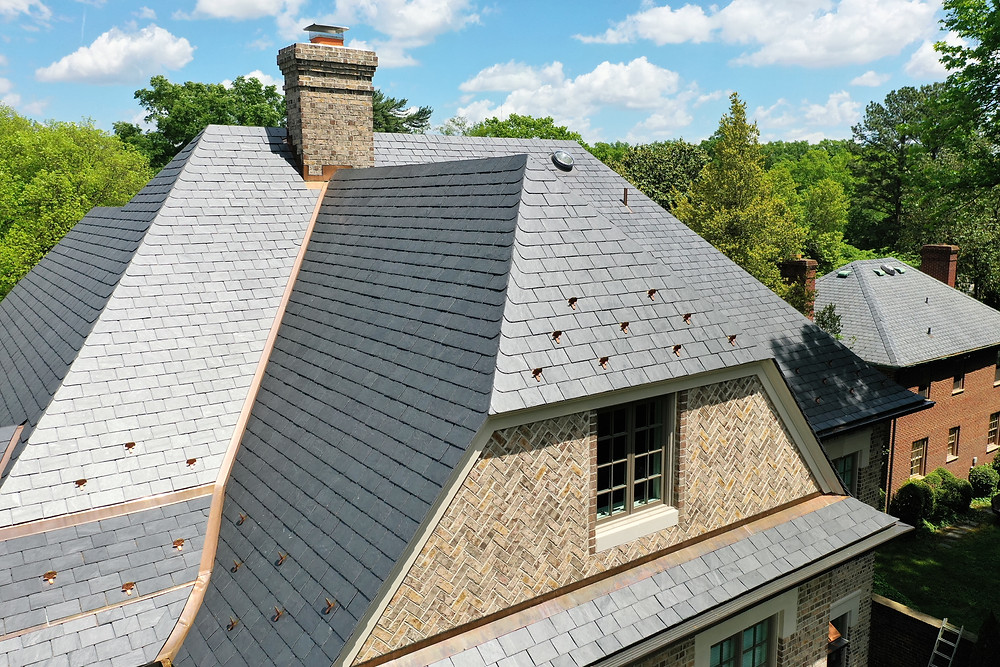 Virginia Slate Company, Slate roofing tiles produced by Virginia Slate Company and installed by  Precision Roofing and Construction. This option is called Unfading Classic Black.