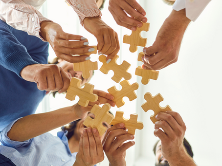 Individual Compensation in Flat Organizations: Solving the Puzzle