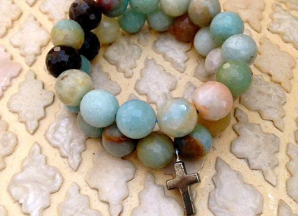 Pair of Large 12mm Faceted Amazonite Beaded Bracelets with Pyrite Stone Cross on light patterned background