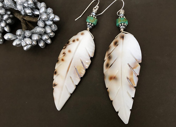 Sterling silver and 3 inch carved shell feather earrings by Breathe Deep Designs