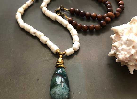 Close up of the Green Indian Jasper Pendant on conch shell and wood beads