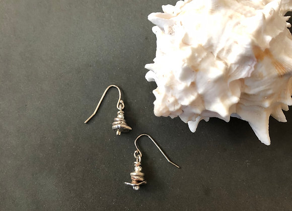 Stacking stones silver nugget earrings next to a shell .75 inches