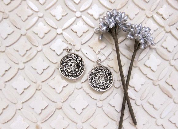 Silvertone Tibetan Calendar Earrings on indian tray