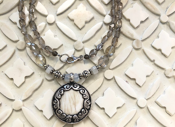 Shell Pendant wrapped in silver on smoky quartz necklace 18 inches long