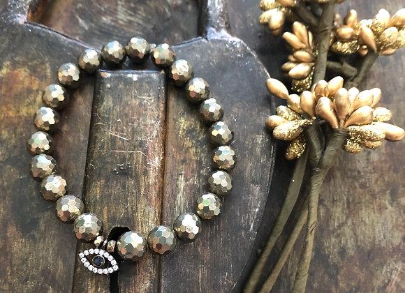 Pyrite Bracelet with Evil Eye white rhinestonesand blue center