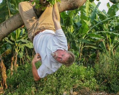 Jayme imitates monkeys he saw while in Uganda.