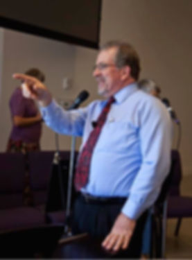 Pastor Jim Wiltbank delivering a comment