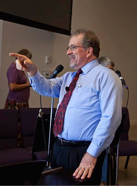 Pastor Jim Wiltbank delivering a comment