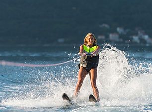 young woman water skiing on a sea.jpg
