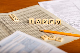 Concept image of tax forms, with Taxes,