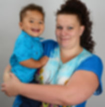 A HOW client and her baby, smiling.