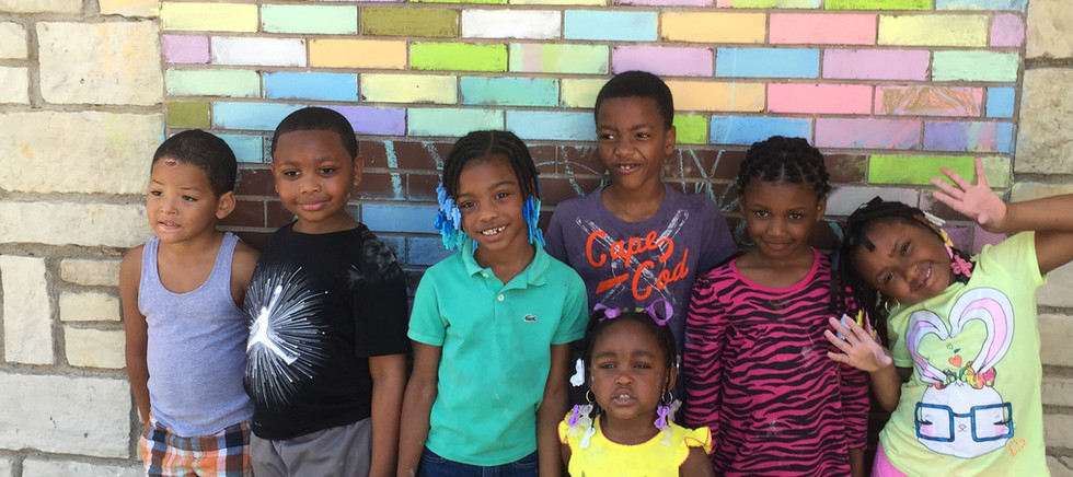 Kids at brick wall.jpg