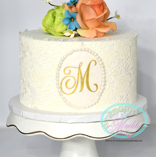 Monogram cutting cake.jpg