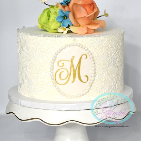 Monogram cutting cake.jpg