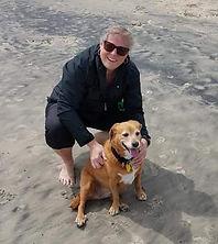 Lisa On Beach With Dog.jpg