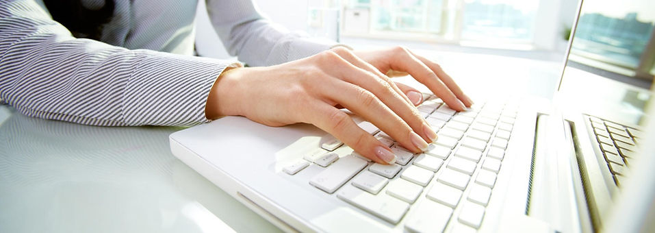 Lady typing on Keyboard