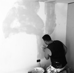 Ciccio paints walls