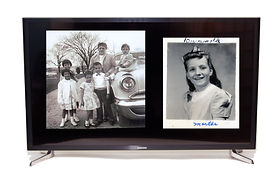 Television showing digitized old photos on the screen