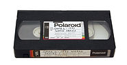 shows old VHS video tape cassette that can be copied to digital