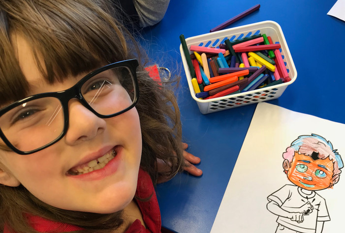 Deaf Student colouring in Jack making th