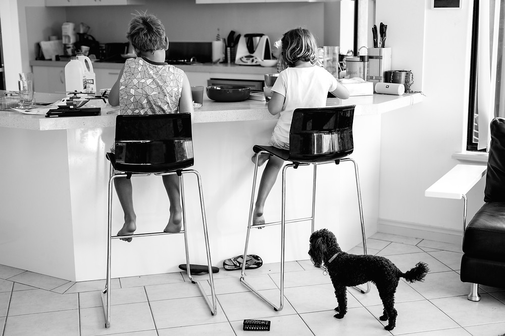 young children on kitchen stools, family life