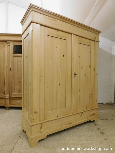 Old pine wardrobe in a clear wax