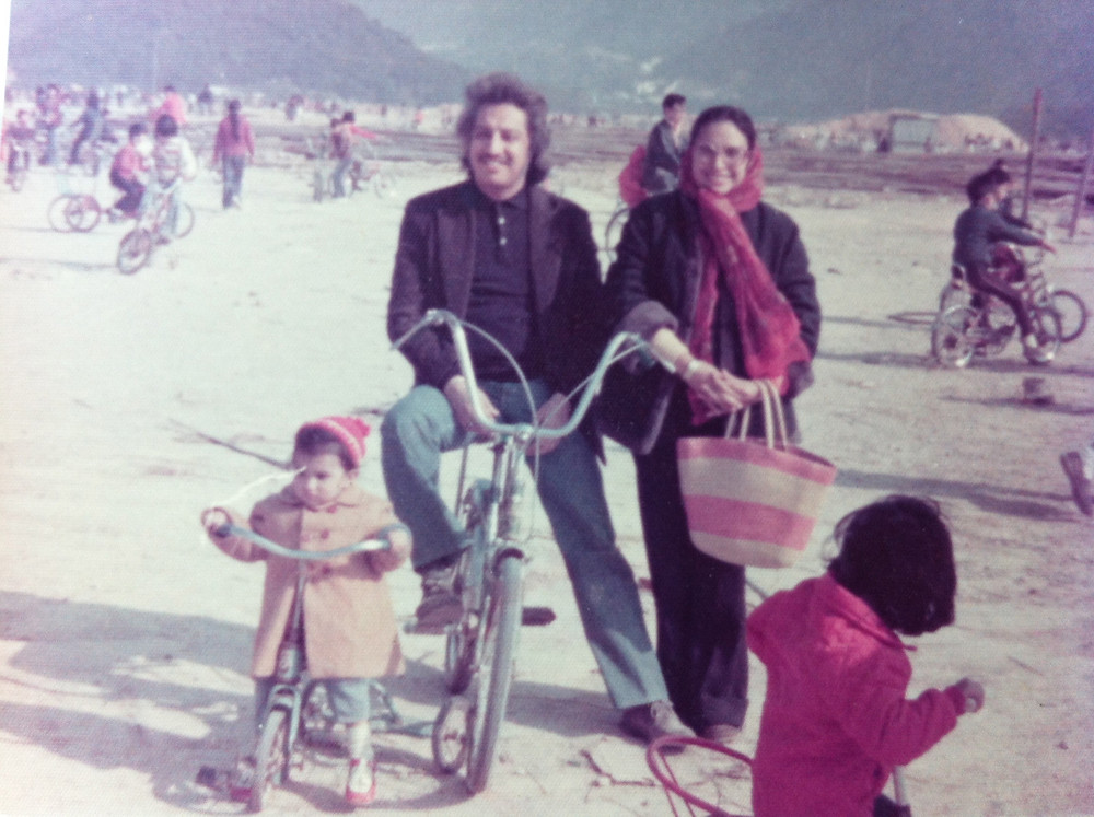 My mom, dad, and me on my tricycle in Shek O