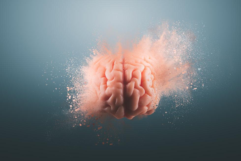 Human brain floating on a gray backgroun