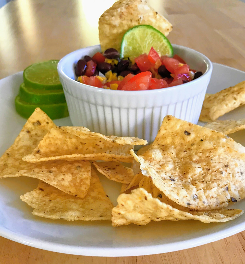 black bean salsa with tortilla chips and limes