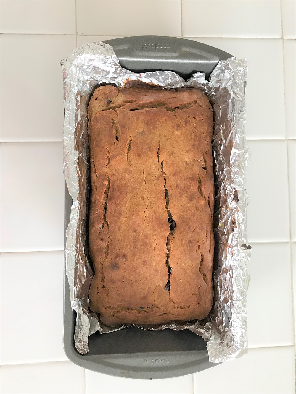 Foil-lined loaf pan with banana bread