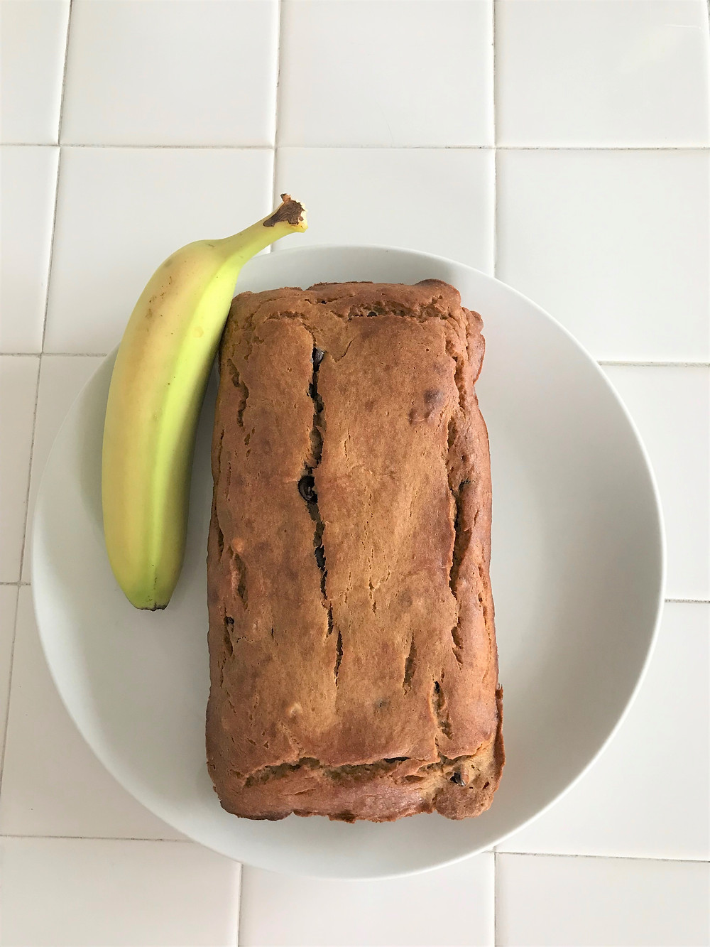banana bread with banana on plate