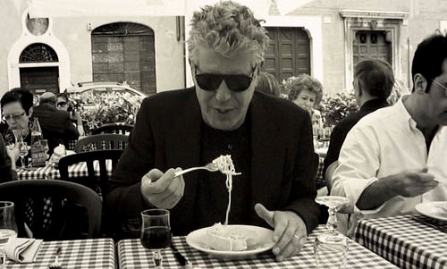 Anthony Bourdain eats a plate of pasta, foreshadowing why NJ will name a food trail after him.