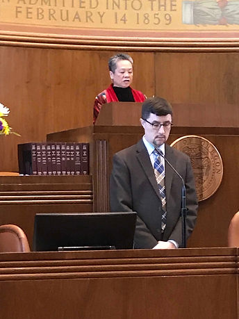 Irene giving invocation.JPG