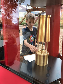 AMS student and oil lamp.JPG
