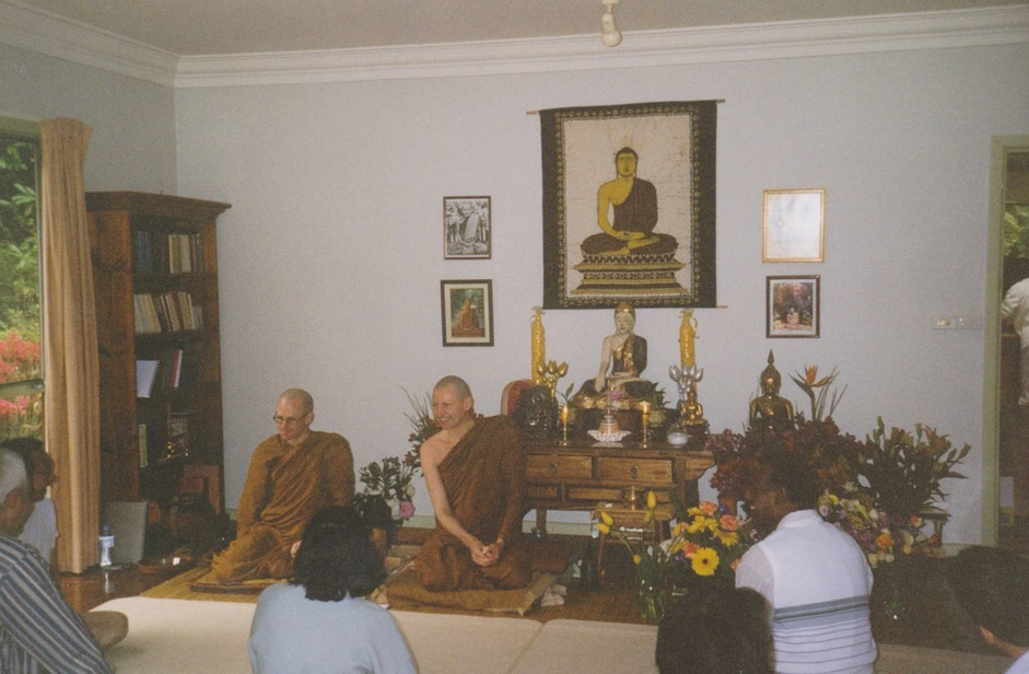 The current abbot, Ajahn Hāsapañño (left) with the first abbot, Ajahn Ian (right) in 2002.