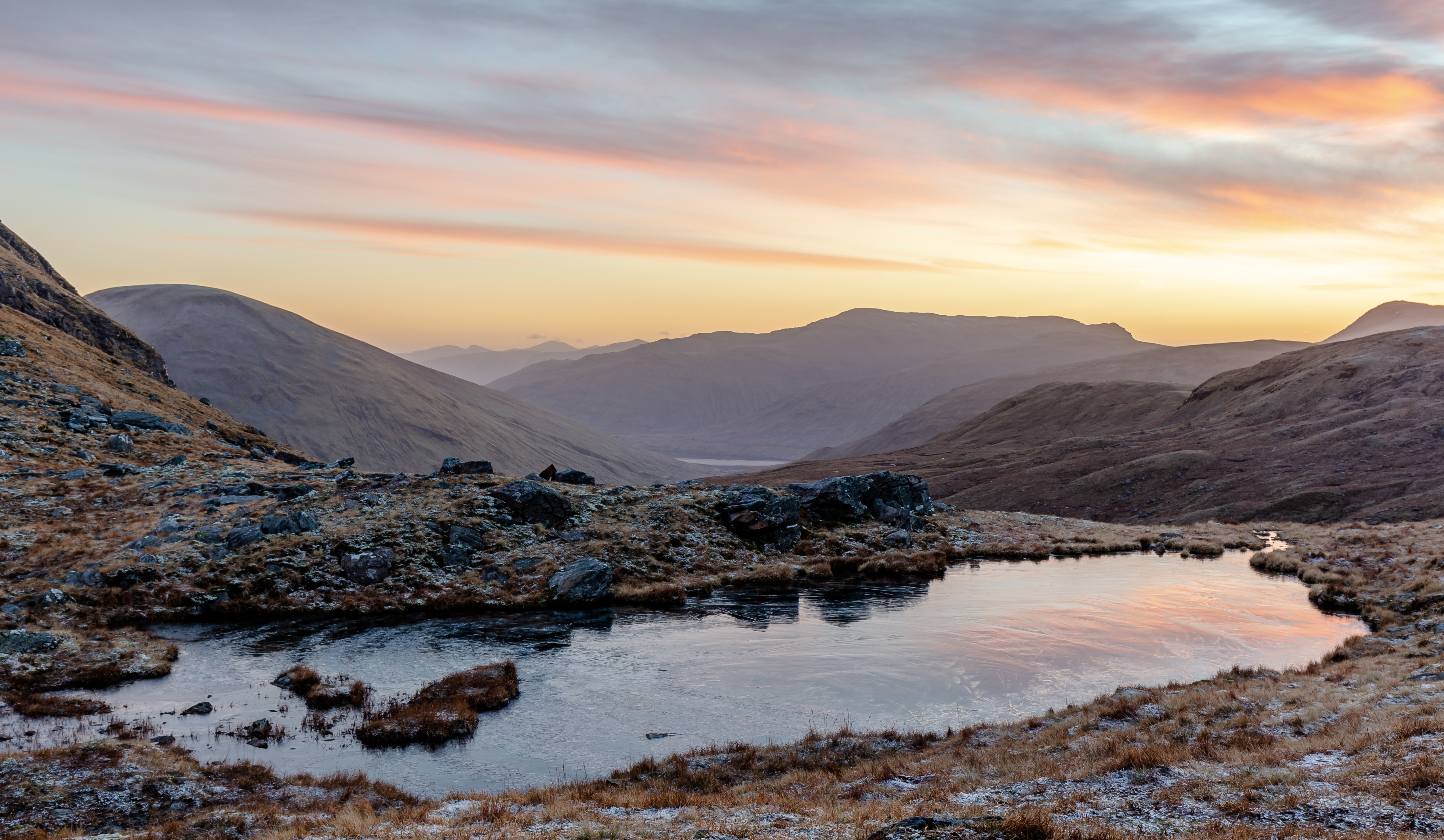 A_small_loch_in_the_saddle_between_Beinn
