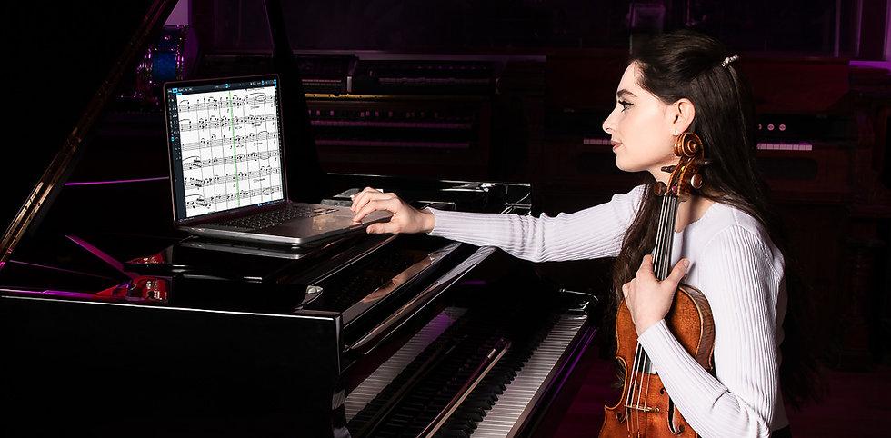 Esther abrami wearing white sweater while recording violin in recording studio