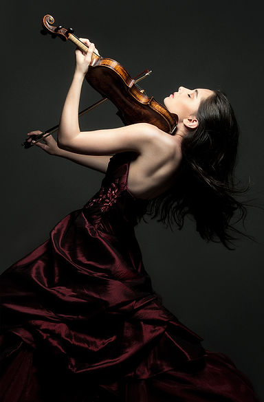 Esther abrami in maroon dress playing the violin
